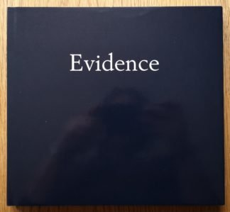 The photography book cover of Evidence by Larry Sultan and Mike Mandel. In dustjacketed hardcover blue with the title in white.