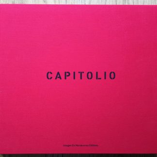 The photography book cover of Capitolio by Christopher Anderson. In hardcover red, with the title in black.
