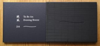 The photography book cover of To Be An Evening Breeze by 214. In slipcased hardcover black, with the title in white.