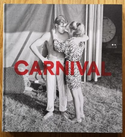 The photography book cover of Carnival by Mark Steinmetz. In hardcover white and grey, with a man and a woman hugging.