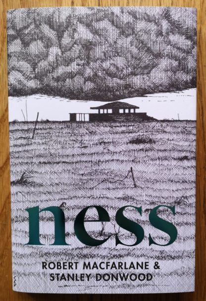 The book cover of Ness by Robert Macfarlane and Stanley Donwood. In dust jacketed hardcover white, with a building in a field.