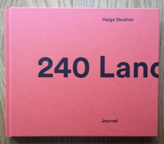 The photography book cover of 240 Landscapes by Helge Skodvin. In hardcover orange, with the title in black.