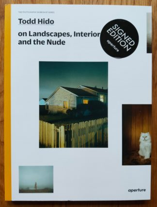 The photography book cover of Todd Hido on Lanscapes, Interiors and the Nude. In softcover white, with a house.