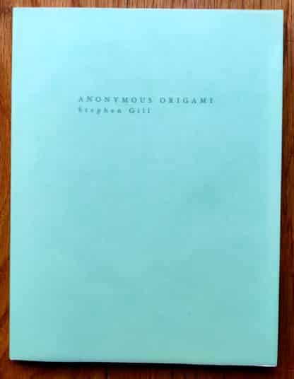 The photography book cover of Anonymous Origami by Stephen Gill. In softcover mint green.