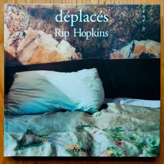 The photography book cover of Deplaces by Rip Hopkins. In hardcover.
