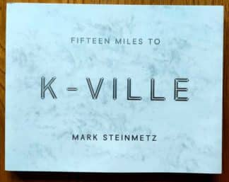 The photography book cover of Fifteen Miles to K-Ville by Mark Steinmetz. In dust jacketed softcover white.
