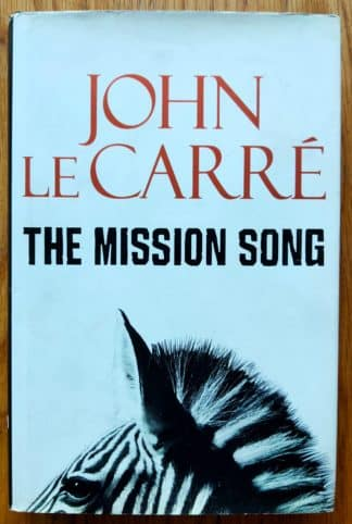 The book cover of The Mission Song by John Le Carre. In dust jacketed hardcover black. The dust jacket is white, with a zebra.