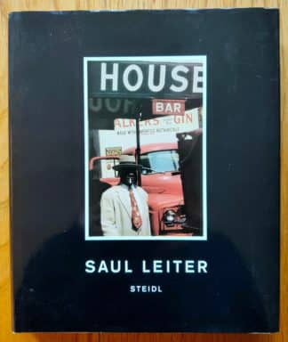 The photography book cover of Saul Leiter. In dust jacketed hardcover grey.