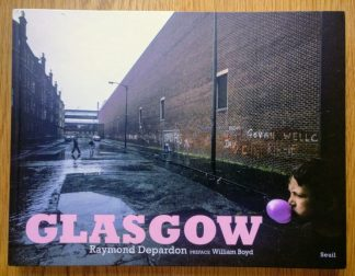 The photography book cover of Glasgow by Raymond Depardon. In hardcover with a kid blowing a bubblegum balloon on a street.