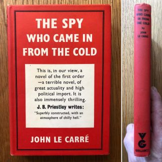 The book cover of The Spy who Came in From the Cold by John Le Carre. In dust jacketed hardcover blue.