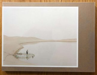 The photography book cover of The Yellow River by Zhang Kechun. In hardcover brown.