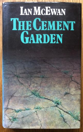 The photography book cover of The Cement Garden by Ian McEwan. In dust jacketed hardcover black.