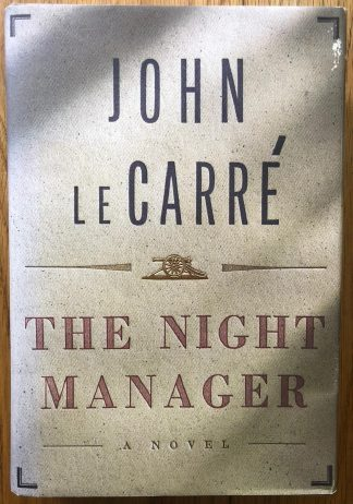 The book cover of The Night Manager by John Le Carre. In dust jacketed hardcover grey.
