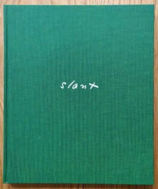 The photography book cover of Slant by Aaron Schuman. In hardcover green.
