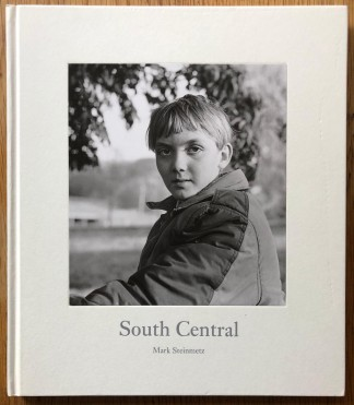 The photography book cover of South Central by Mark Steinmetz. In hardcover white.