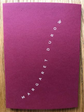 The photography book cover of 002 - Margaret Durow. In softcover red.