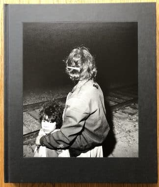 The photography book cover of Midnight La Frontera by Ken Light. In hardcover black.