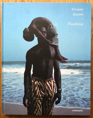 The photography book cover of Flamboya by Viviane Sassen. In hardcover with a man carrying a child on his head.