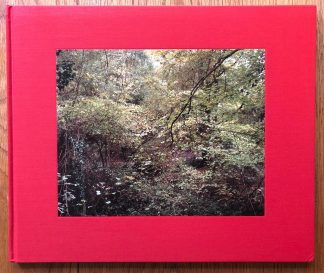 The photography book cover of The Painter's Pool by Jem Southam. In hardcover red.