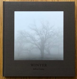 The photography book cover of Winter by Jeffrey Conley. In hardcover brown.