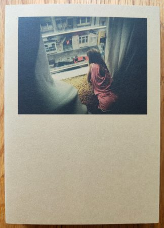 The photography book cover of An Attic Full of Trains by Alberto di Lenardo. In softcover brown.
