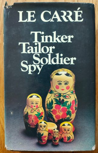 The book cover of Tinker Tailor Soldier Spy by John Le Carre. In dust jacketed hardcover black.