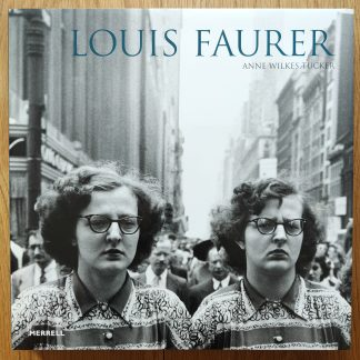 The photography book cover of Louis Faurer by Louis Faurer. In dust jacketed hardcover blue.