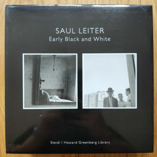The photography set cover of Early Black and White by Saul Leiter. In two dust jacketed hardcovers black.