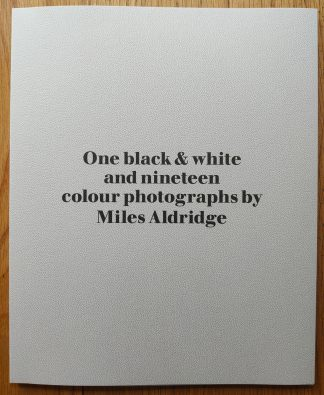 The photography book of One black & white and nineteen colour photographs by Miles Aldridge. In softcover pink.