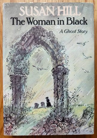 The book cover of The Woman in Black by Susan Hill. In dust jacketed hardcover green.