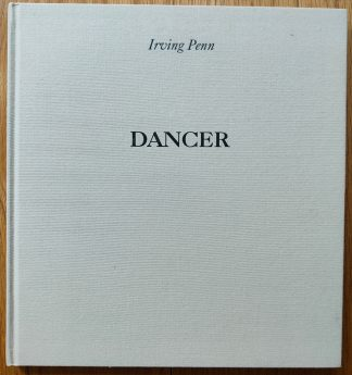 The photography book cover of Dancer by Irving Penn. In hardcover beige with the title and author's name in black.