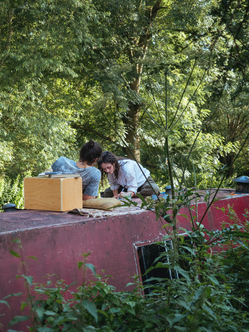 Couple lounging on top of barge