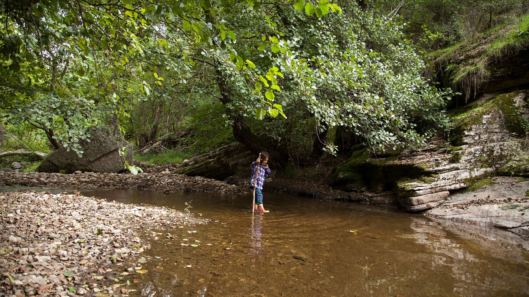 Young girl playing in river
