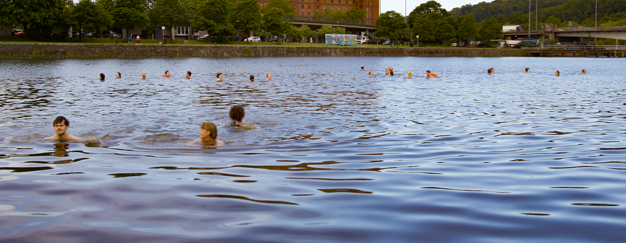 Swimmers in the water at Bristol Harbour as part of a floating protest