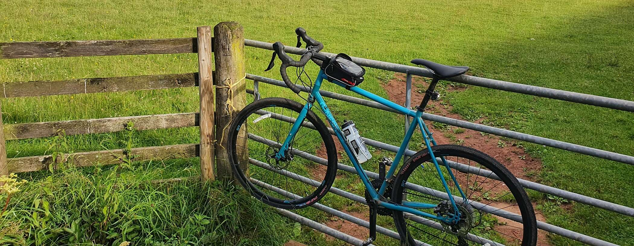 Bicycle leaning against a fence in the South Wales countryside