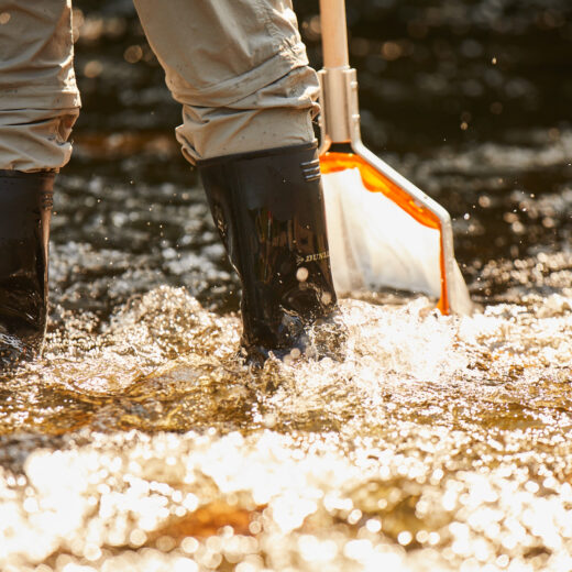 Wellies in river