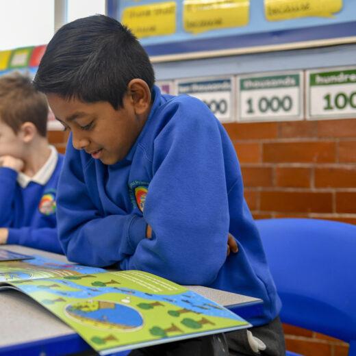 Schoolchildren read a book about an adventurous salmon