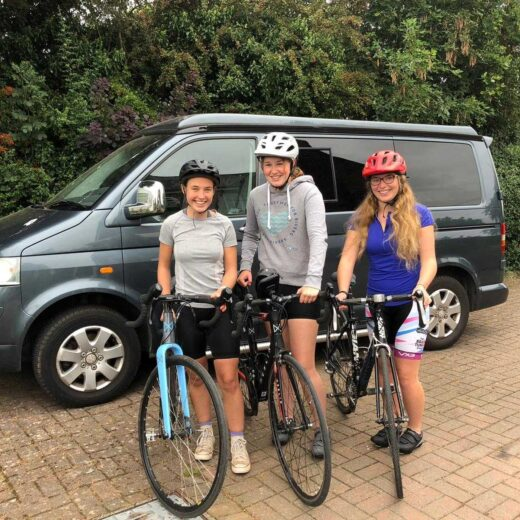 Right to left: Georgia, Martha, and Sally on their bikes ready to cycle from Land's End to Glasgow