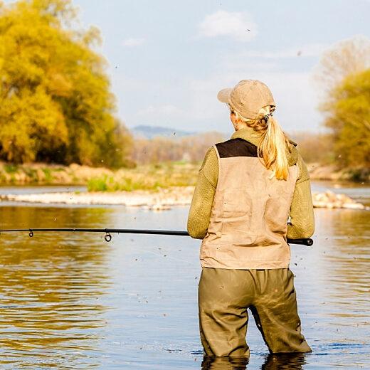 Woman fishing in river