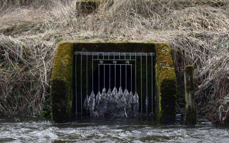 Sewage outfall blocked by wet wipes leading into river