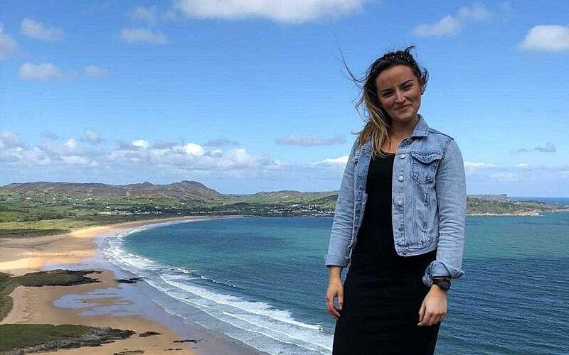 Lisa Stewart walking on the beach
