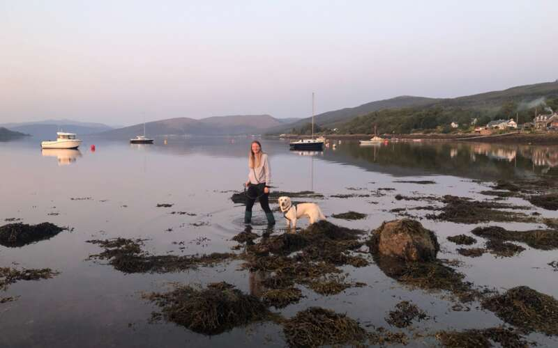Seren with pet dog by the coast