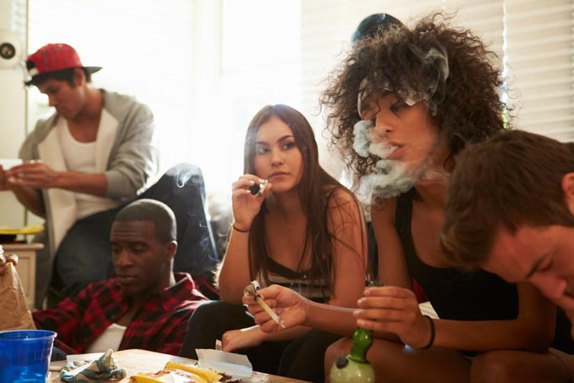 teenagers smoking socially together