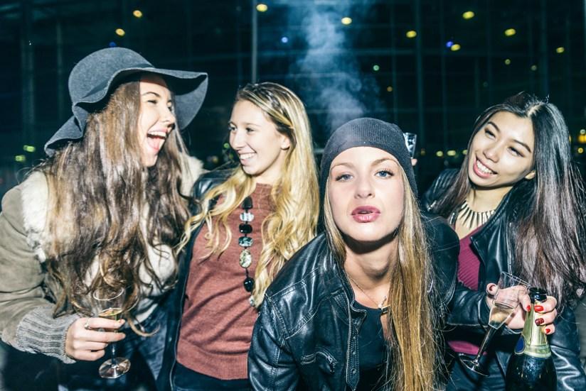 group of girls socially smoking together