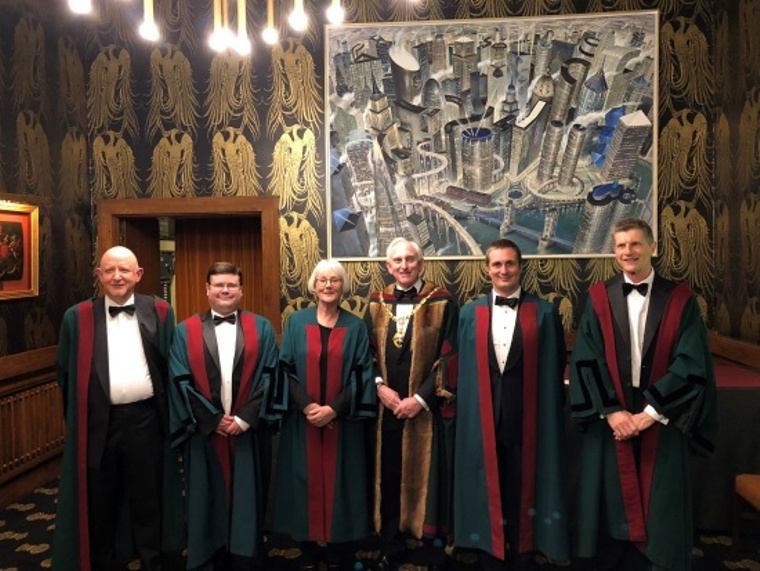 Images of members standing. Members are Chris Grant, Joe Wood, Alison Swan Parente, The Master, Tim Monger-Godfrey, Stephen Ville