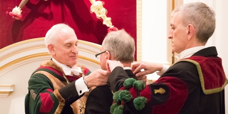 Incoming Master presenting outgoing Master with badge of office as Deputy Master