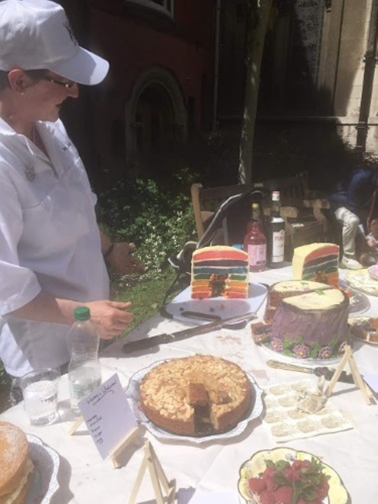 Liveryman Sara Autton judges the entries of the Guild of Young Freemen charity Bake Off