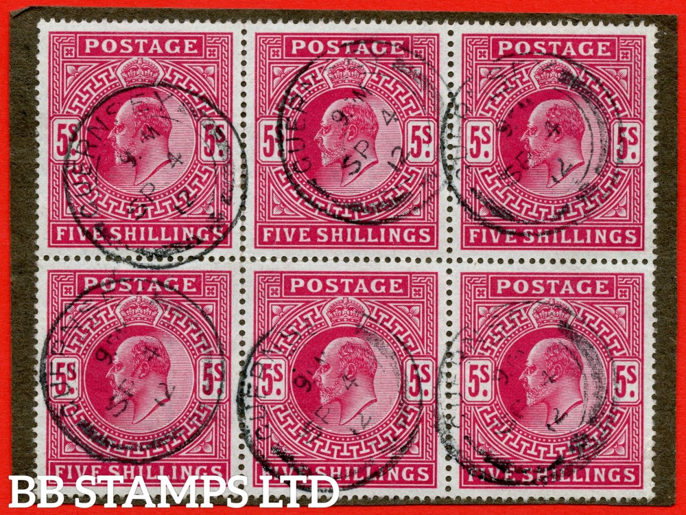 "SG. 318. M52 (2). 5/- Carmine. A very fine "" 4th September 1912 GUERNSEY "" CDS used block of 6 on small piece. A RARE used multiple."