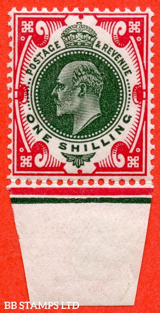 "SG. 314. M47 (5) d. 1/- Green & Carmine. A superb UNMOUNTED MINT bottom marginal example with the listed "" Vertical scratch at back of ear ( PL.H2a ) and bottom frame broken ( Pl. B5. Row 20/11 ). No date cuts in marginal rule."
