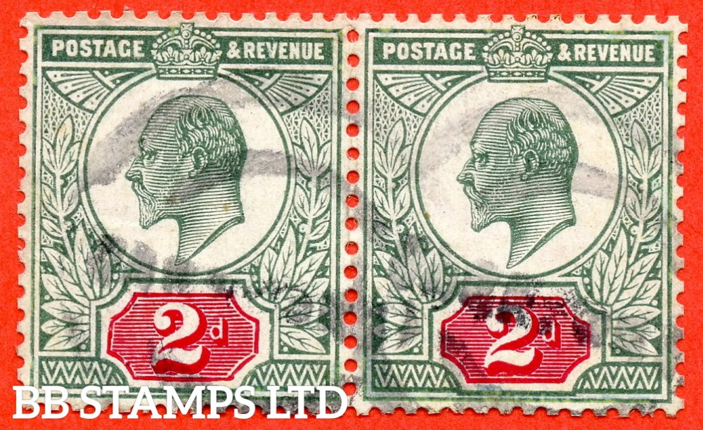 "SG. 227. M12 (1) b. 2d Pale Grey Green & Carmine Red ©. A used pair with the left hand stamp having the RARE listed variety "" distorted tablet ( ""Rhombus"". Early state. Plate D3. Row 1/1 ) ""."